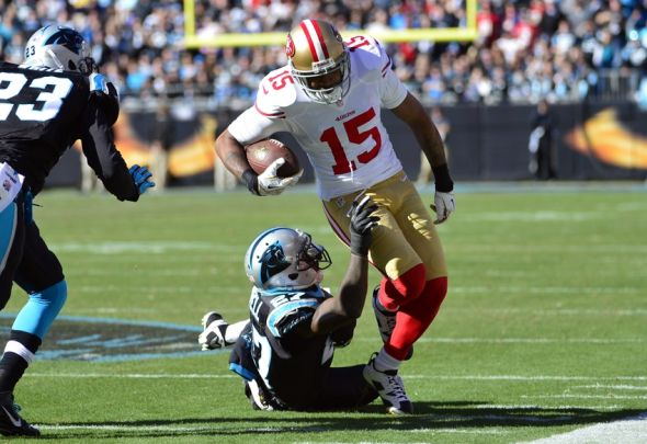 Jan 12, 2014; Charlotte, NC, USA; San Francisco 49ers wide receiver Michael Crabtree (15) is tackled by Carolina Panthers strong safety Quintin Mikell (27) during the first quarter of the 2013 NFC divisional playoff football game at Bank of America Stadium. Mandatory Credit: Bob Donnan-USA TODAY Sports